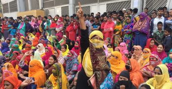 Garment workers take to the streets demanding wages in Savar